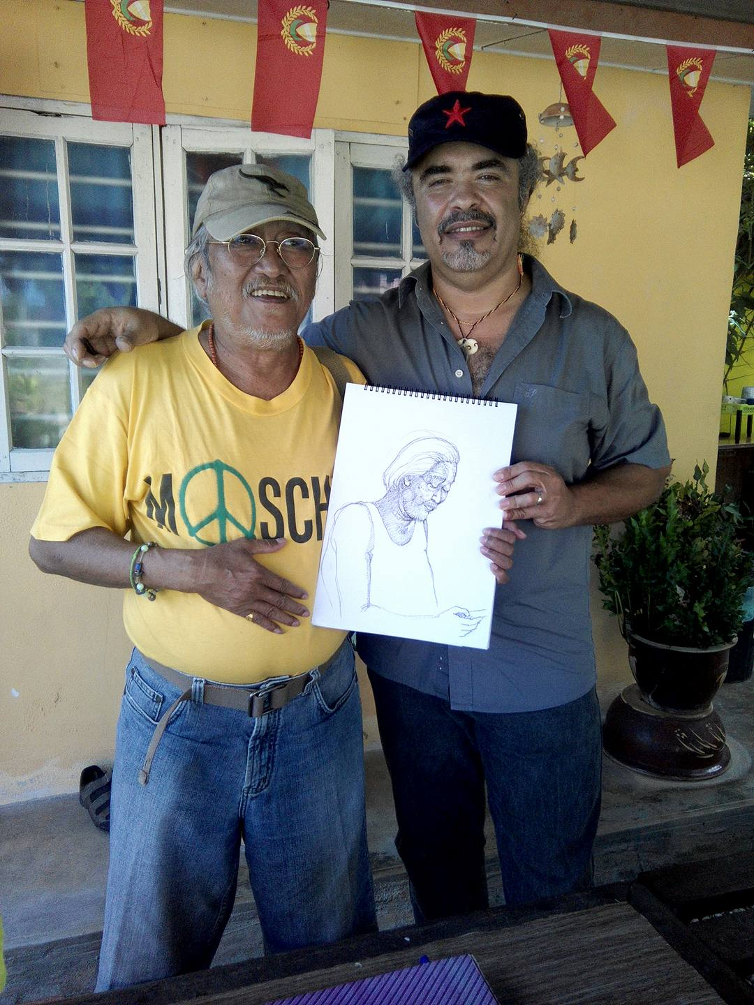 "The artists are at it again! Charly gives the sketch he made for Freddy, this time. The three of them: Celso, Freddy and Charly have this ""Draw me, I'll draw you"" kind of a game and been exchanging sketches since the time we arrived in Kuala Lumpur."