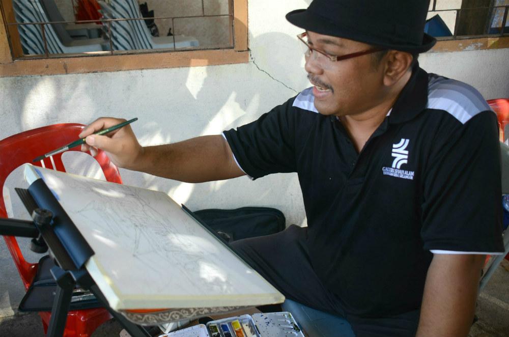 برخی از هنرمندان در گوشه ای ازمراسم مشغول به نقاشی