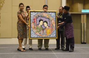 اهدای نقاشی توسط هنرمند مالزیایی